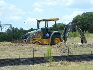 Tractors at the ready to begin site preparation for Austin's new Airpark Home community in Lakeway Texas by Zbranek & Holt Custom Homes.